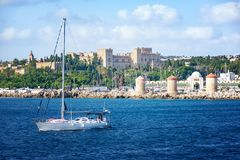Sail boats in front of Grand Master palace in City of Rhodes Rhodes, Greece royalty free stock photo