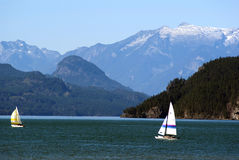 Sail boats on Horseshoe Bay near Cypress Mountain with. The Lions twin peaks in the background Howe Sound British Columbia Stock Images
