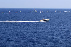 Sail boats and a jet boat. In the sea in Gerona Royalty Free Stock Images