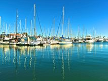 Sail boats in Marina. Sail boats with reflections in bright beautiful water of Channel Islands Harbor Marina in Oxnard California Ventura stock photography
