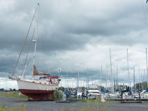 Sail boats and ominous skies Stock Images