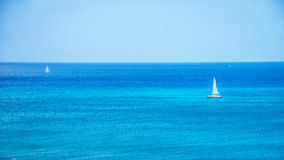 Sail Boats in the Pacific Ocean just off the coast at Ko Olina Royalty Free Stock Photo