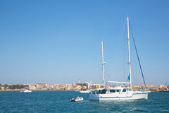 Sail boats in the port of Syracuse in Sicilia. Royalty Free Stock Image