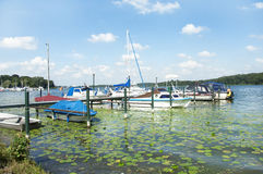 Sail Boats on a private landing place for boats. Many boats with no people on a big river in berlin germany Stock Images