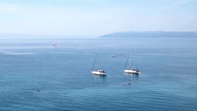 Sail boats on the sea time lapse stock footage