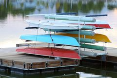 Sail boats stack up on dock Stock Image