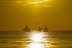 Sail boats at sunset, Boracay Island, Philippines Stock Images