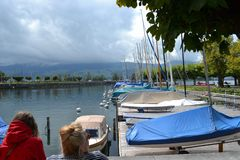 Sail boats on trailers, Rapperswil Jetty, clouds and hills on the horizon Stock Photography
