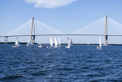 Sail boats under bridge Stock Photo
