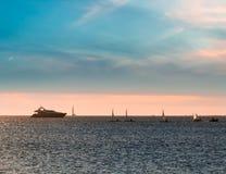 Sail boats and yacht at sunset Royalty Free Stock Photos