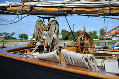 Sail, boom, mooring rope and steering mechanism Royalty Free Stock Photography