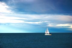 Sail in calm sea Royalty Free Stock Image