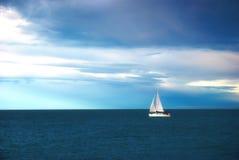 Sail in calm sea. Sail into calm blue sea Royalty Free Stock Image