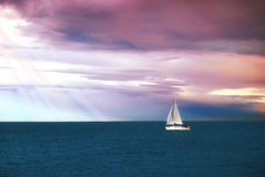 Sail in calm water Stock Images