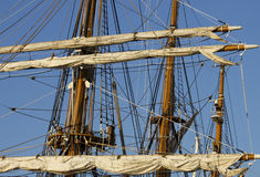 Sail detail. Trees an sails of an old tall sailing ship Stock Photography