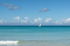 Sail on the horizon of blue ocean Stock Photography