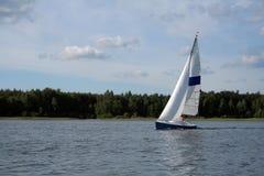 Sail on the lake. Boat on the lake near Powidz (Poland Stock Image