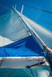 Sail of a large monohull boat under strong wind stock image