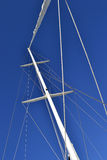 Sail mast on blue background. Composition of  thin lines of a sail mast with clear blue sky background Royalty Free Stock Image