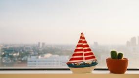 Sail model and cactus. Stock Photos
