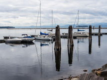 Sail moored at pier on lake Stock Images