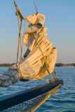 Sail of an Old Boat. Docked in a harbour lit by sunset light Royalty Free Stock Photo