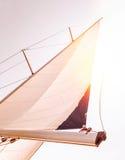 Sail over sunset sky Stock Photo