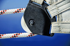 Sail pulley and ropes. A photo of the corner of a yacht sail with rope and pulley Royalty Free Stock Image