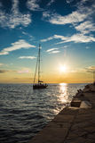 Sail returning to docks in the evening Royalty Free Stock Photos