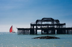 Sail and the ruin. In Brighton, UK Stock Photo