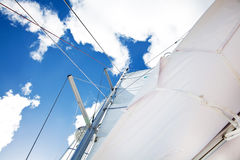 Sail of a sailing boat over bue sky. Sail of a sailing boat over bright bue sky stock photo