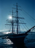 Sail ship. At dock back lit by sun Royalty Free Stock Photos
