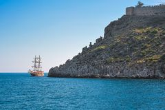 Sail ship and ancient fortress Royalty Free Stock Photos