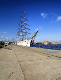 SAIL SHIP IN HARBOUR. Sail ship moored in the harbour under blue skies Royalty Free Stock Photo
