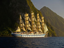 Sail ship near mountain island Stock Image