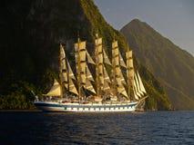 Sail ship near mountain island stock image