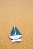 Sail Ship Toy Model in the Beach Sand Stock Image