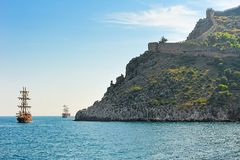 Sail ships and ancient fortress Royalty Free Stock Image