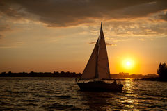 Sail into sunset Stock Photo