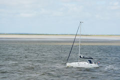 Sail yacht at Dutch wadden sea Stock Photography