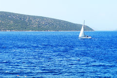 The sail yacht on turquoise water Stock Image