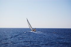 Sail yacht  in windy sea Royalty Free Stock Image