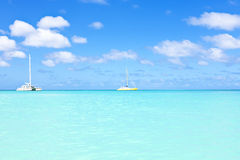 Sail yachts in a blue caribean sea. On Aruba Stock Images