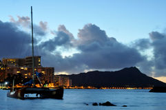 Sailboad anchored near Diamond Head at Waikiki Stock Photos