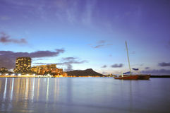 Sailboad anchored near Diamond Head at Waikiki Stock Images