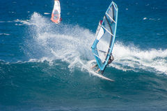 Sailboarder jumps the waves Royalty Free Stock Images