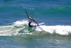 Sailboarder Windsurfing A Wave In Hawaii Royalty Free Stock Photos