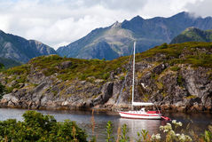 Sailboat. Sailing with mountains in the background Royalty Free Stock Image