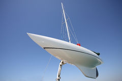 Sailboat. A hoisted sailboat  over blue sky Royalty Free Stock Photos
