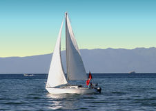 Sailboat. Sailor and sailboat on quiet lake Stock Photography